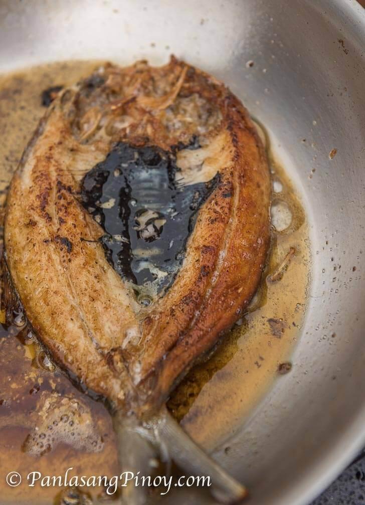 Daing na Bangus Frying on a Pan