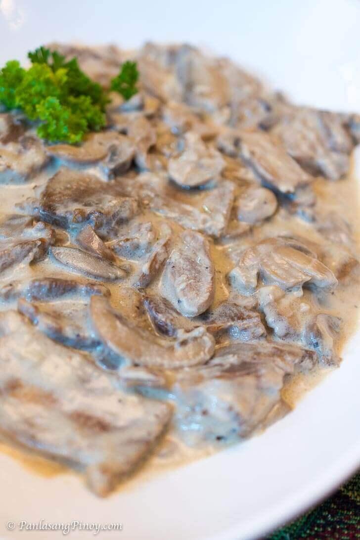Lengua in White Mushroom Sauce