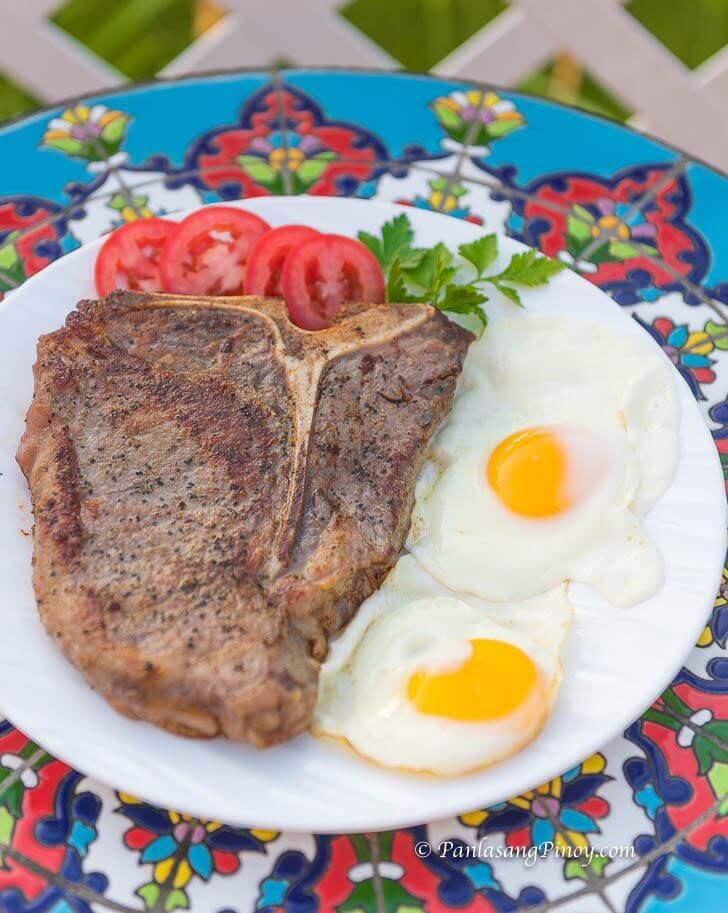 breakfast t-bone steak with eggs